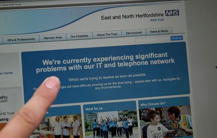 zzzzinte1In this posed picture photograph, a woman points to the website of the NHS: East and North Hertfordshire notifying users of a problem in its network, in London on May 12, 2017.  Several British hospitals were hit by cyber attacks on Friday, the country's health service said, forcing some to divert ambulances to other clinics and urge people not to try to contact their doctors. / AFP PHOTO / Daniel LEAL-OLIVASzzzz