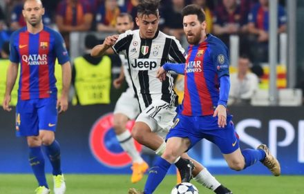 Juventus' forward from Argentina Paulo Dybala (C) vies with Barcelona's Argentinian forward Lionel Messi during the UEFA Champions League quarter final first leg football match Juventus vs Barcelona, on April 11, 2017 at the Juventus stadium in Turin.  / AFP PHOTO / GIUSEPPE CACACE        (Photo credit should read GIUSEPPE CACACE/AFP/Getty Images)