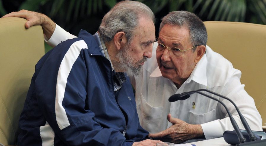 (FILES) This file photo taken on April 21, 2011 shows former Cuban president Fidel Castro (L) listening to his brother Raul, Cuban President and new First Secretary of the Central Committee of the Communist Party (CCPCC), during the final session of the 6th Cuban Communist Party Congress, on April 19, 2011 at the Convention Palace in Havana. After surviving more than 600 assassination attempts, defying 10 US presidents and shaping half a century of history, Fidel Castro celebrates his 90th birthday Saturday. / AFP PHOTO / ADALBERTO ROQUE / TO GO WITH AFP STORY
