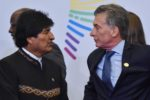 zzzzinte1Bolivia's President Evo Morales (L) speaks with Argentina's President Mauricio Macri during the family photo of the Eighth Americas Summit in Lima, on April 14, 2018. US strikes on Syria overshadowed the Americas Summit, which ends Saturday condemning corruption and calling for more sanctions on the Venezuelan government. / AFP PHOTO / CRIS BOURONCLEzzzz